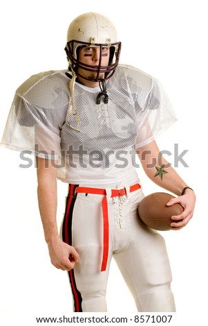 American football player. Standing with helmet and ball. - stock photo