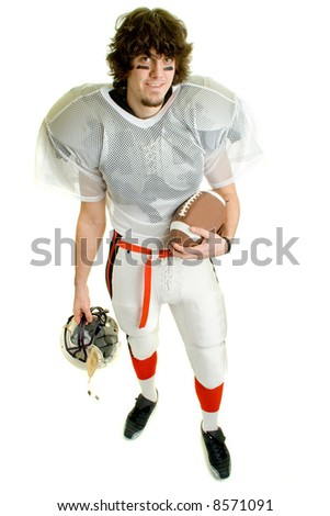 American football player. Standing with helmet and ball.