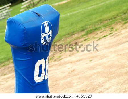American football practice - one man from a tackling sled - stock photo