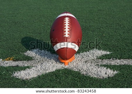 American Football ready for kickoff - stock photo