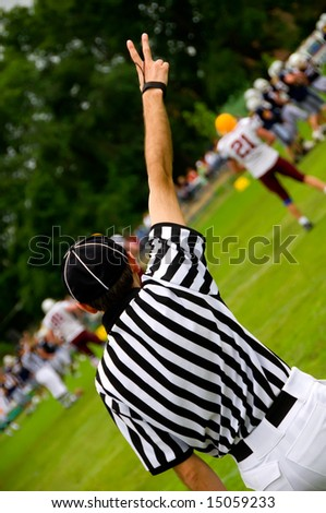 American football referee with hands up - Judge concept - stock photo