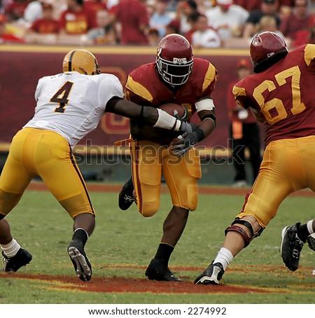 American Football Running Back Crosses the Line - stock photo