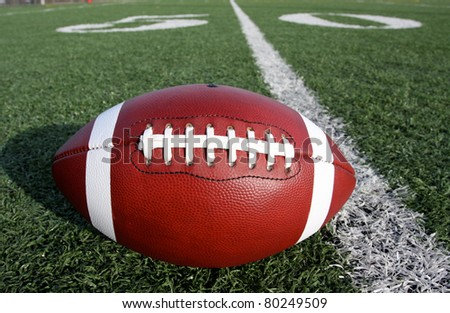 American Football with the Fifty Yard Line - stock photo