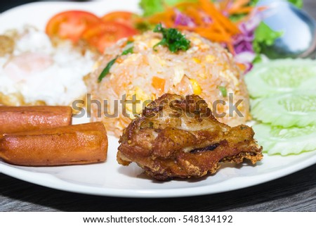 American fried rice on plate on wood table