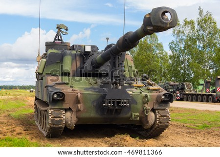 american howitzer stands on a battlefield