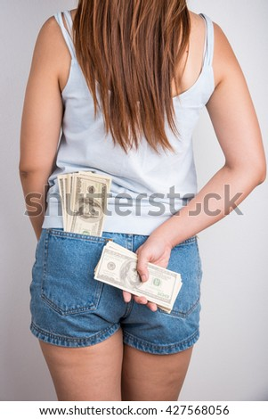 American hundred dollar bills in the pocket of jeans - stock photo