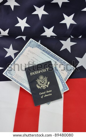 American I.D. Documents Passport Birth Certificate Social Security Card United States of America Flag - stock photo