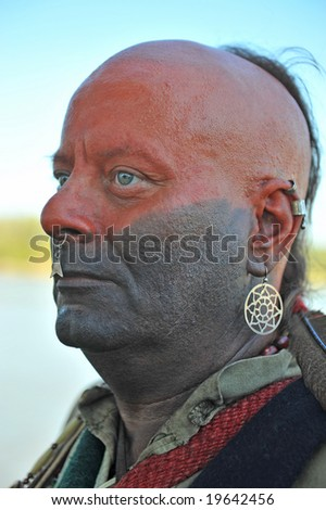 American Indian dressed in war paint - stock photo