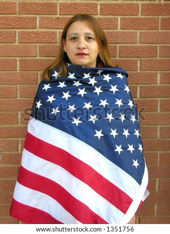 American Indian Woman wrapped in American Flag - stock photo