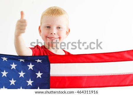 American little boy showing thumb up. American flag on the front