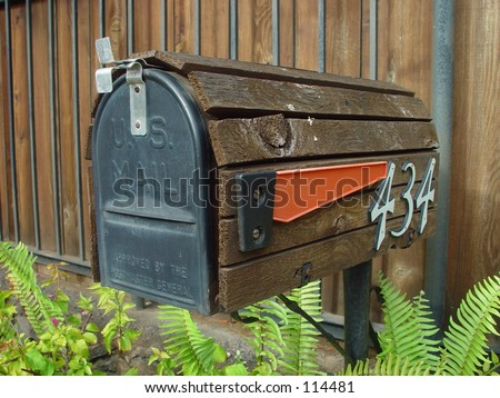 American mailbox covered with wood with flag down - stock photo