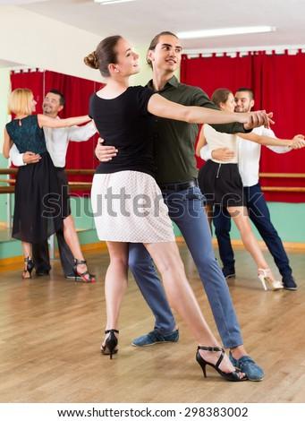american men and women enjoying of tango in class - stock photo