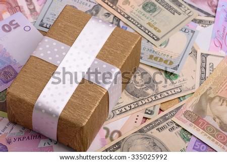 american money and golden gift box, european money - stock photo