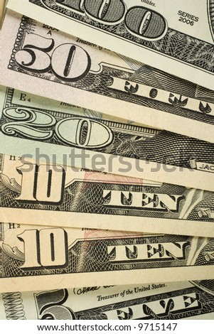 American money fanned out. 100, 50, 20, 10, and 5 dollar notes. - stock photo