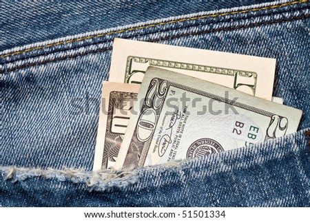 american money in a blue jeans pocket - stock photo