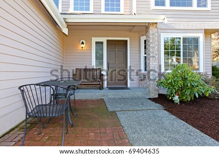 American Northwest style large home front facade. - stock photo