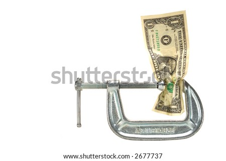 American one US dollar bill squeezed in a clamp isolated on white as metaphor of loosing buying power - stock photo