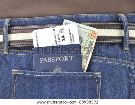 American Passport Airline Boarding Pass Twenty Dollar Bill in Denim Blue Jean Pants Pocket of International Traveler - stock photo
