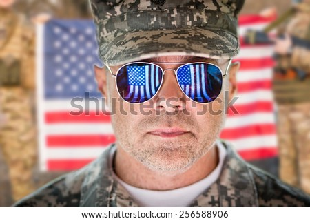 American patriot soldier concept over american flag background. soft daylight - stock photo