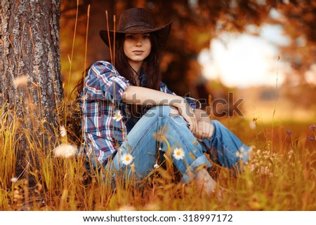 American portrait of a young woman farmer Indian Summer - stock photo