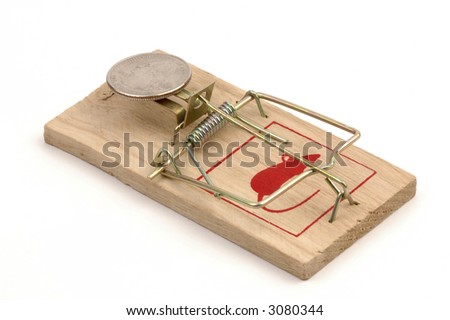 American quarter as bait on a loaded mousetrap. - stock photo