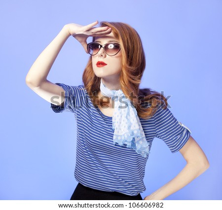 American redhead girl in suglasses. Photo in 60s style. - stock photo