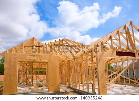 American residential wooden house construction detail in blue sunny day sky - stock photo