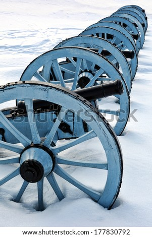 American Revolutionary War cannons battery in an artillery position in winter snow at Valley Forge National Historical Park military camp of the Continental Army near Philadelphia in Pennsylvania