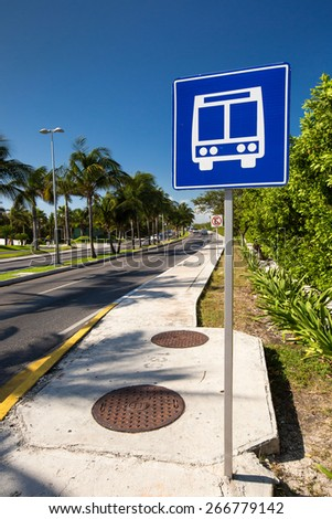 American road public bus stop sign on caribbean street road - stock photo