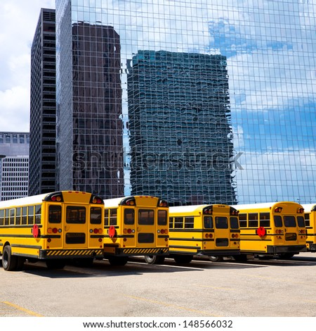 American school bus rear view in a row at Houston skyline photo mount - stock photo