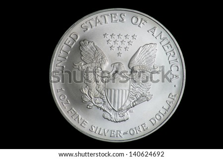American Silver Eagle Dollar coin with Heraldic eagle with shield and thirteen five-pointed stars. - stock photo