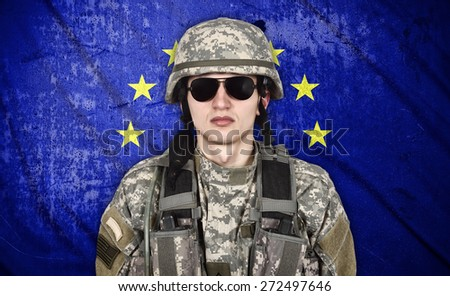 american soldier and European Union flag on background - stock photo