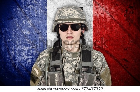 american soldier and France flag on background - stock photo