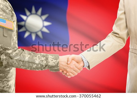American soldier in uniform and civil man in suit shaking hands with national flag on background - Taiwan - stock photo