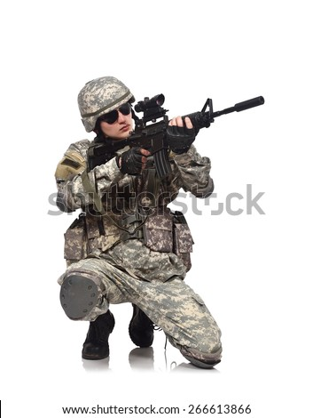 American soldier kneeling with rifle - stock photo