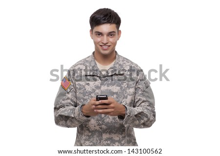 American soldier using a cell phone  - stock photo