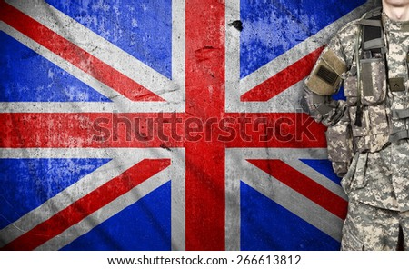 American soldier with UK flag on background - stock photo