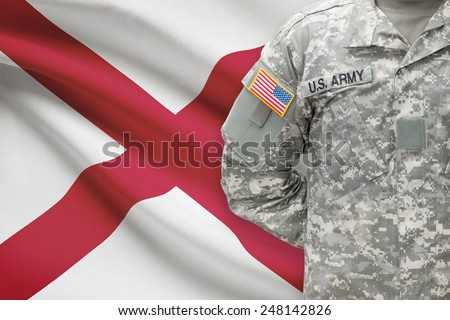 American soldier with US state flag on background - Alabama - stock photo
