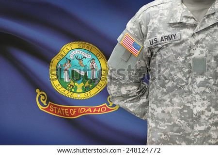 American soldier with US state flag on background - Idaho - stock photo