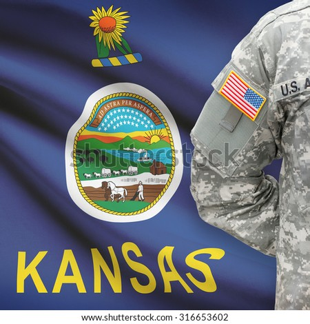 American soldier with US state flag on background series - Kansas - stock photo