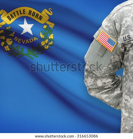 American soldier with US state flag on background series - Nevada - stock photo