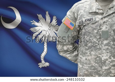 American soldier with US state flag on background - South Carolina - stock photo