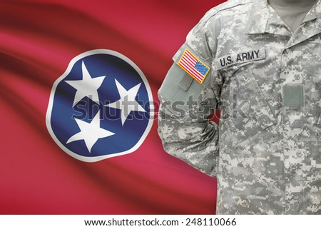 American soldier with US state flag on background - Tennessee - stock photo