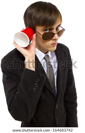 American spy wearing black suit and holding a cup - stock photo
