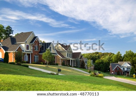 American street with beautiful houses - stock photo