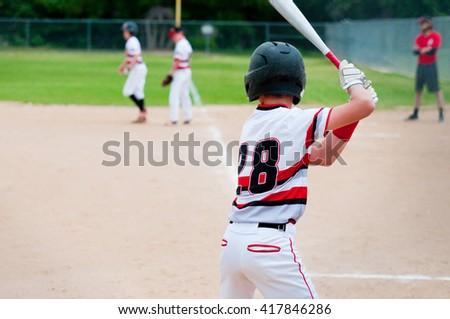 Youth baseball player batting