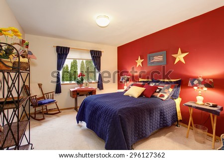 American themed guest bedroom with red white and blue decor. - stock photo
