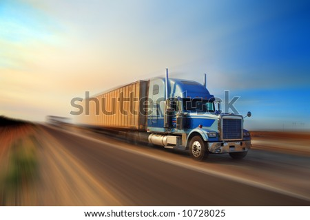 American truck speeding on freeway at sunset, motion blurred. - stock photo