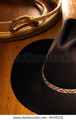 American West Rodeo cowboy black felt hat and ranching lasso
