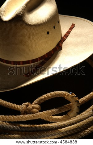 American West rodeo cowboy white straw hat and lasso